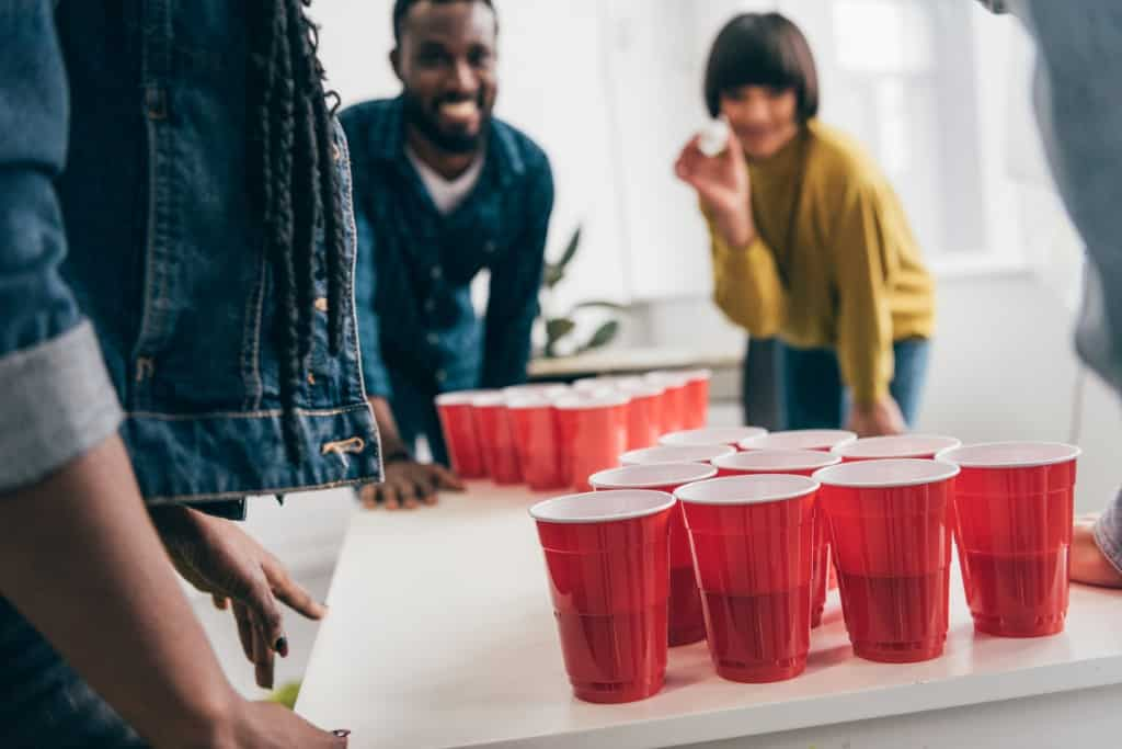 young-adults-playing-beer-pong